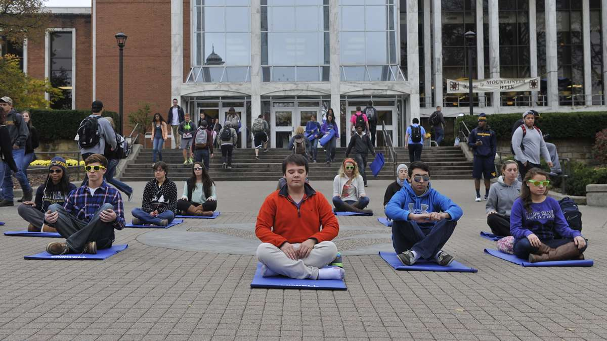 WVU students meditating in front of the Mountainlair